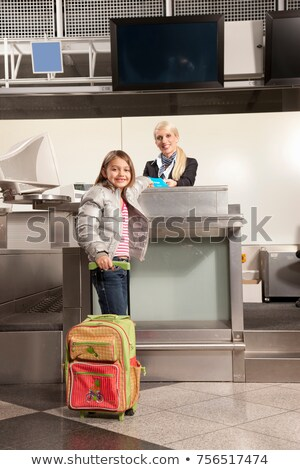 Young girl checkin in for her flight Stock photo © IS2
