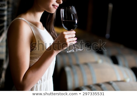 Winegrower in wine-cellar holding glass of wine Stock photo © FreeProd