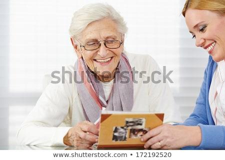 Idős nő család album nappali kanapé Stock fotó © IS2