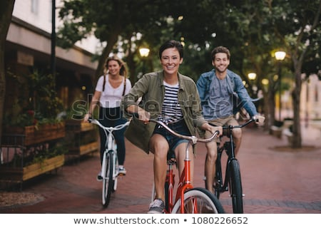 Friends cycling Stock photo © IS2