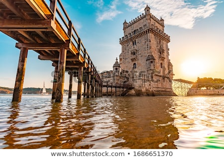 Lisboa puente anochecer paisaje urbano 25 puente colgante Foto stock © vichie81