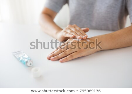close up of hands with cream or therapeutic salve stock photo © dolgachov
