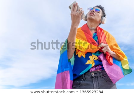 Androgynous man talking on mobile phone Stock photo © wavebreak_media