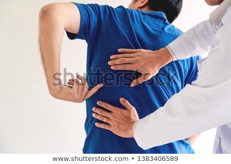 Chiropractor erkekler ayarlamak gülümseme kitap Stok fotoğraf © toyotoyo