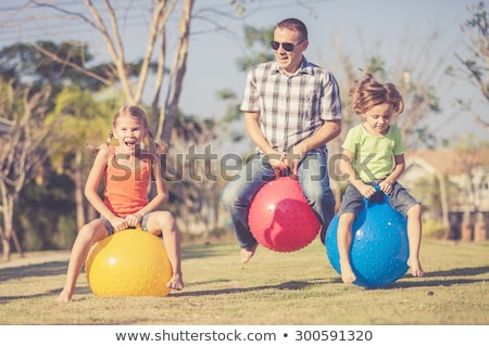 Happy father and daughter having fun outdoors. Stock photo © szefei