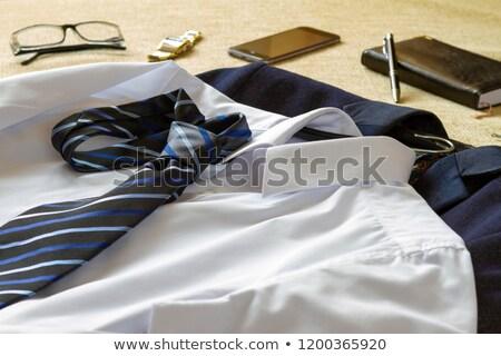 Uomo d'affari vestiti accessori letto smartphone moda Foto d'archivio © manaemedia