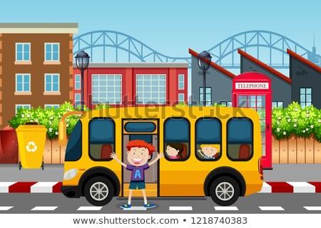 Boy infront of school bus scene Stock photo © bluering