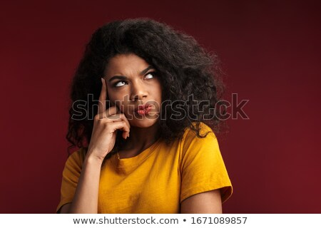 Photo of unhappy african american woman touching temples, isolat Stock photo © deandrobot