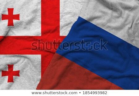 Zdjęcia stock: Two Waving Flags Of Russia And Georgia