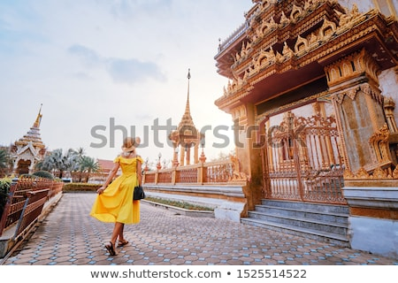 Woman tourist in the background of Thai temple Wat Chalong stock photo © galitskaya
