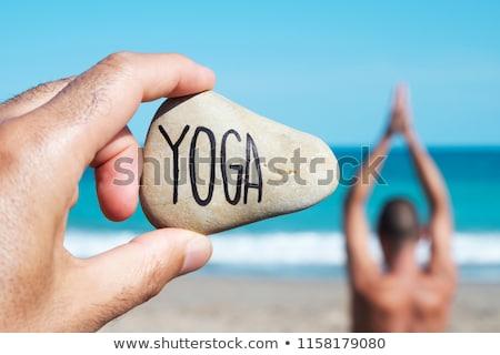 yogi man and text yoga in a stone Stock photo © nito