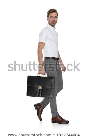 side view of a intrigued  man walking with his suitcase  Stock photo © feedough