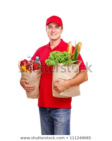 delivery man carrying two grocery shopping bags with food stock photo © kzenon