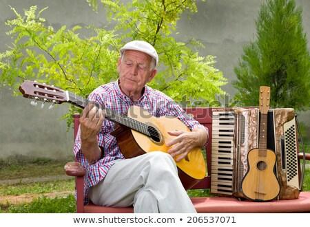 Foto stock: Personas · jugando · música · jardín · ilustración · guitarra