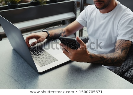 Man holding laptop with social media notifications Stock photo © ra2studio
