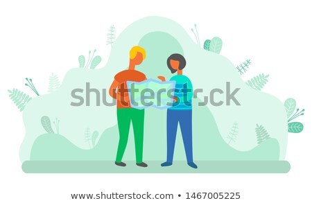 people traveling man and woman reading map atlas stock photo © robuart