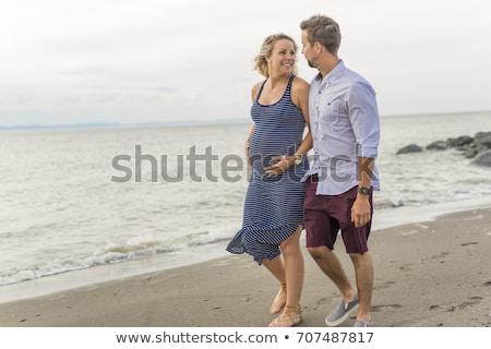 terhes · nő · tengerpart · zsebkendő · nő · víz · kezek - stock fotó © lopolo