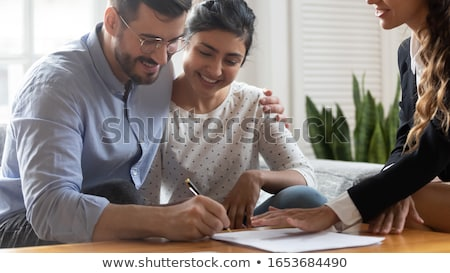 Real Estate Agent Helping Client In Filling Contract Form Stock photo © AndreyPopov