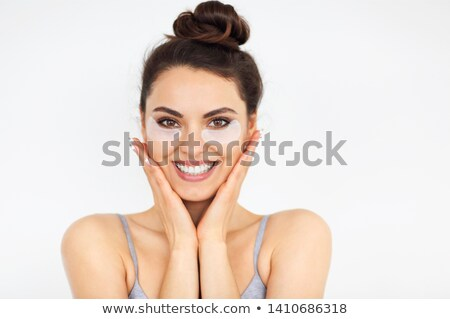 Funny girl with black patches under her eyes  Stock photo © dashapetrenko