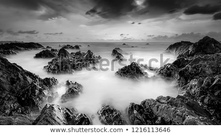 Stock photo: View of a rocky coast in the morning. Long exposure shot.