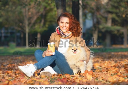 Young couple walking with coffee to go in the autumn park Stock photo © boggy