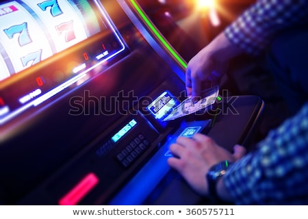 Man plays slot machine in casino Stock photo © jossdiim