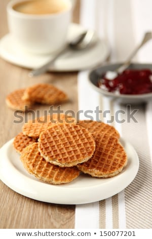 Cup of coffee and mini stroopwafels (syrupwaffles) with jam Stock photo © Melnyk