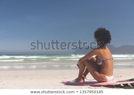 Oldalnézet női szörfös szörfdeszka ül tengerpart Stock fotó © wavebreak_media