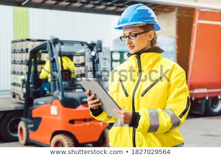 Supervisor checking contents of shipment to be sent by truck Stock photo © Kzenon