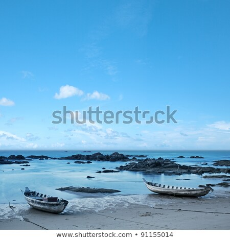 Wooden boats moored by the wave line. Long exposure shot. Square Stock photo © moses