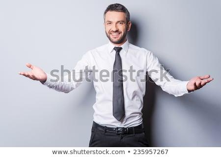jovem · empresário · abrir · brasão · isolado · homem - foto stock © feedough