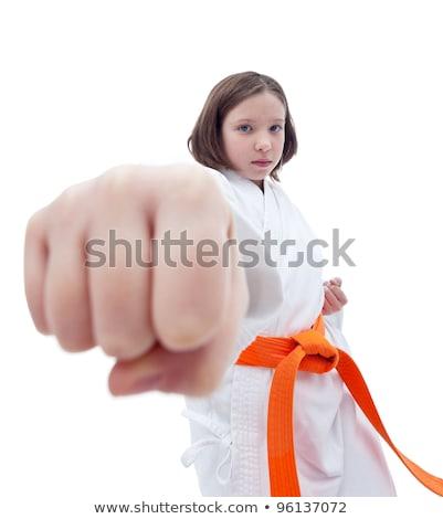 Karate kız yumruk ön plan ciddi el Stok fotoğraf © ilona75