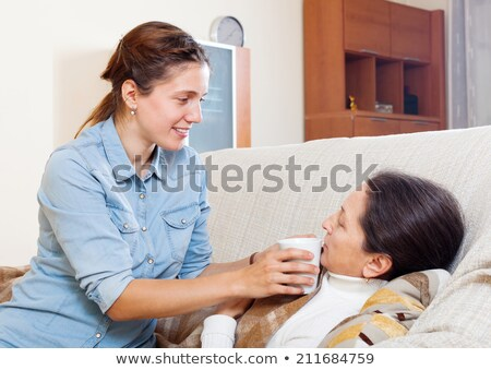 Stock photo: Daughter helping mother take medication
