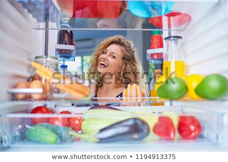 donna · guardando · alimentare · frigorifero · vista · posteriore - foto d'archivio © konradbak