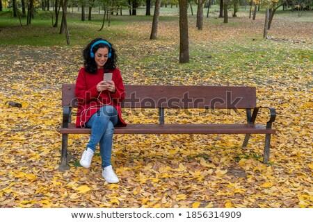 brunette woman in a red-orange wool sweater stock photo © imarin