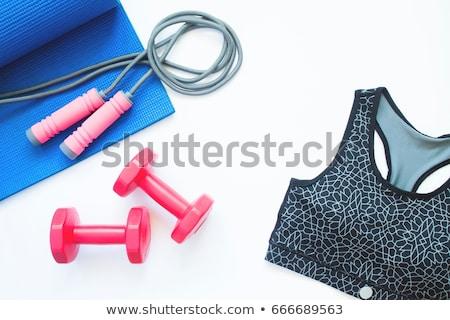 Woman laying on gym mat Stock photo © photography33