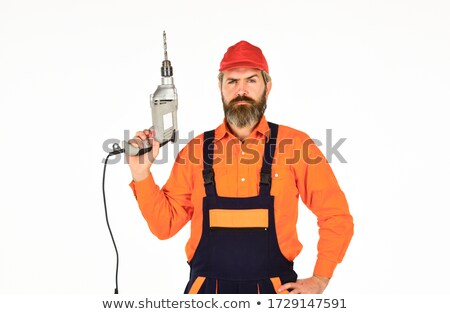 man drilling wall stock photo © photography33