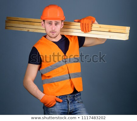 Labourer carrying planks of wood Stock photo © photography33