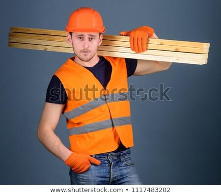Segédmunkás hordoz deszkák fa állás stock Stock fotó © photography33