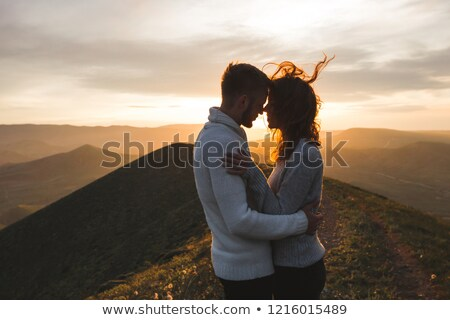 Kissing in romantic scenery Stock photo © konradbak