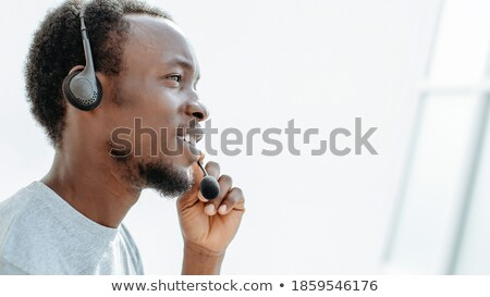 Charismatic male executive with headset on  Stock photo © wavebreak_media