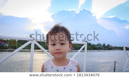 two beautiful young girls on the background of the river 1 stock photo © acidgrey