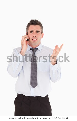 portrait of a disappointing man making a phone call against a white background stock photo © wavebreak_media