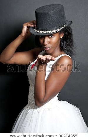 Woman in wedding dress blowing a kiss stock photo © wavebreak_media