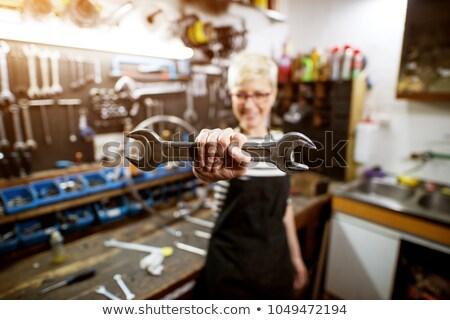 Beautiful female mechanic holding wrench stock photo © wavebreak_media