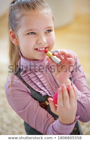 Cute blond girl with red lipstick on her lips Stock photo © dash