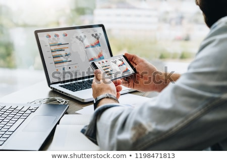 Businessman using a portable notepad computer Stock photo © stryjek