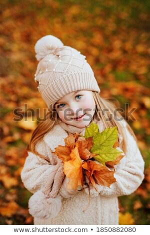 Beautiful blond girl on a back yard's lawn Stock photo © Nejron