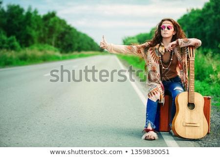 Hippie girl hitchhiking Stock photo © Witthaya