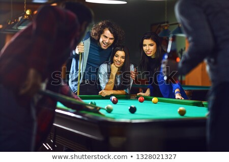 woman with cue and billiard ball Stock photo © 26kot